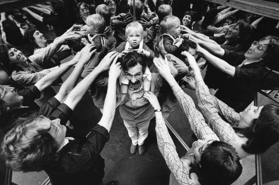 April 16, 1986: Rik Myslewski (left) and Marilyn Bancel (left) both worked at the Exploratorium. One-year-old daughter Carey is on nanny David Wilson\'s shoulders.