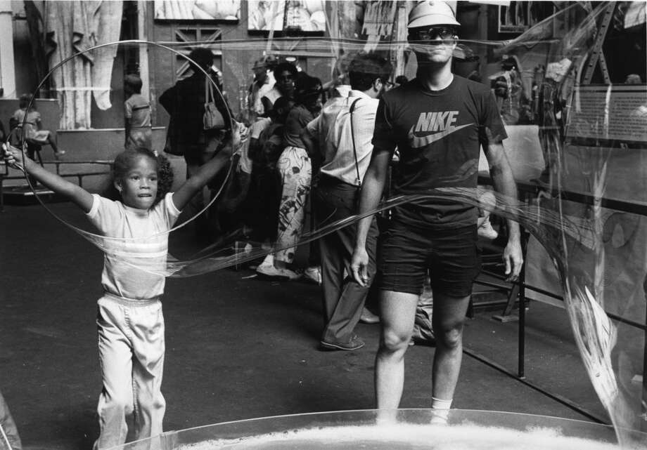 1987: I screwed around with this giant bubble hoop ion the 1980s as well. This and the cow eyeball dissection were two of the more memorable exhibits at the Exploratorium. The Nike shirt dude on the left is representative of the end of the short shorts era for men.