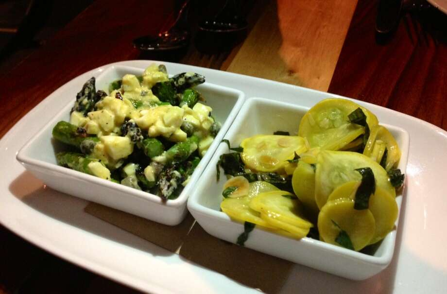 Grilled asparagus with egg and capers (left) and squash with basil and almonds