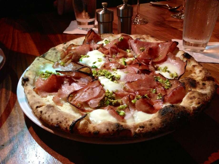 Mortadella pizza with buffalo mozzarella, grana padano and pistachio