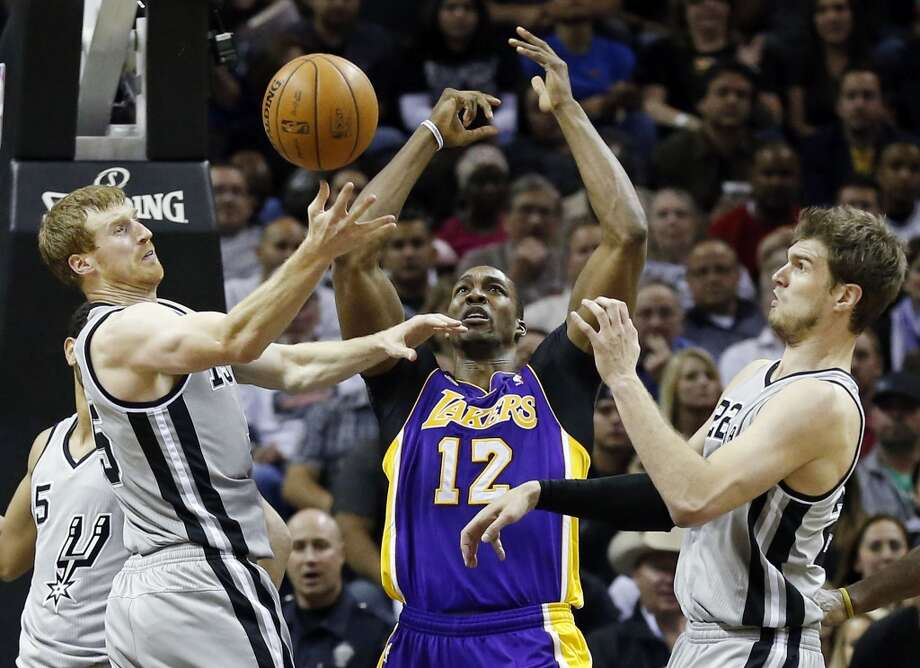 San Antonio Spurs' Matt Bonner and San Antonio Spurs' Tiago Splitter grab for a rebound against Los Angeles Lakers' Dwight Howard during second half action of game 2 in the first round of the NBA Playoffs Wednesday April 24, 2013 at the AT&T Center. The Spurs won 102-91.