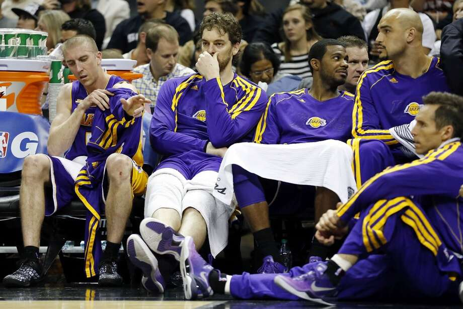 Members of the Lakers sit dejected on the bench during second half action of game 2 in the first round of the NBA Playoffs against the San Antonio Spurs Wednesday April 24, 2013 at the AT&T Center. The Spurs won 102-91.