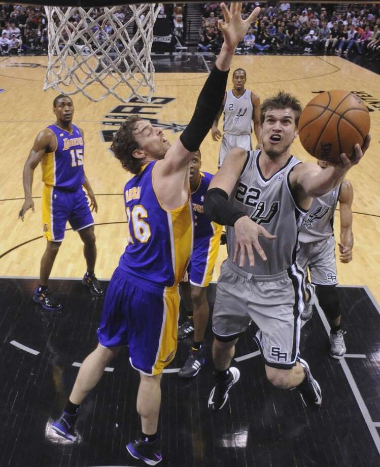 San Antonio Spurs' Tiago Splitter shoots around Los Angeles Lakers' Pau Gasol during first half action of game 2 in the first round of the NBA Playoffs Wednesday April 24, 2013 at the AT&T Center. The Spurs won 102-91.