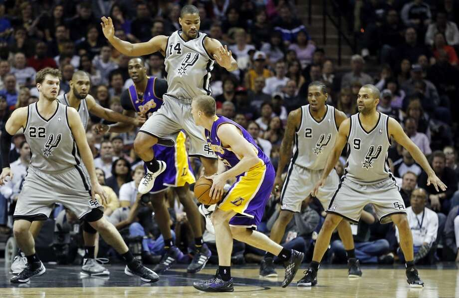 Los Angeles Lakers' Steve Blake looks for room around San Antonio Spurs' Gary Neal and others during second half action of game 2 in the first round of the NBA Playoffs Wednesday April 24, 2013 at the AT&T Center. The Spurs won 102-91.