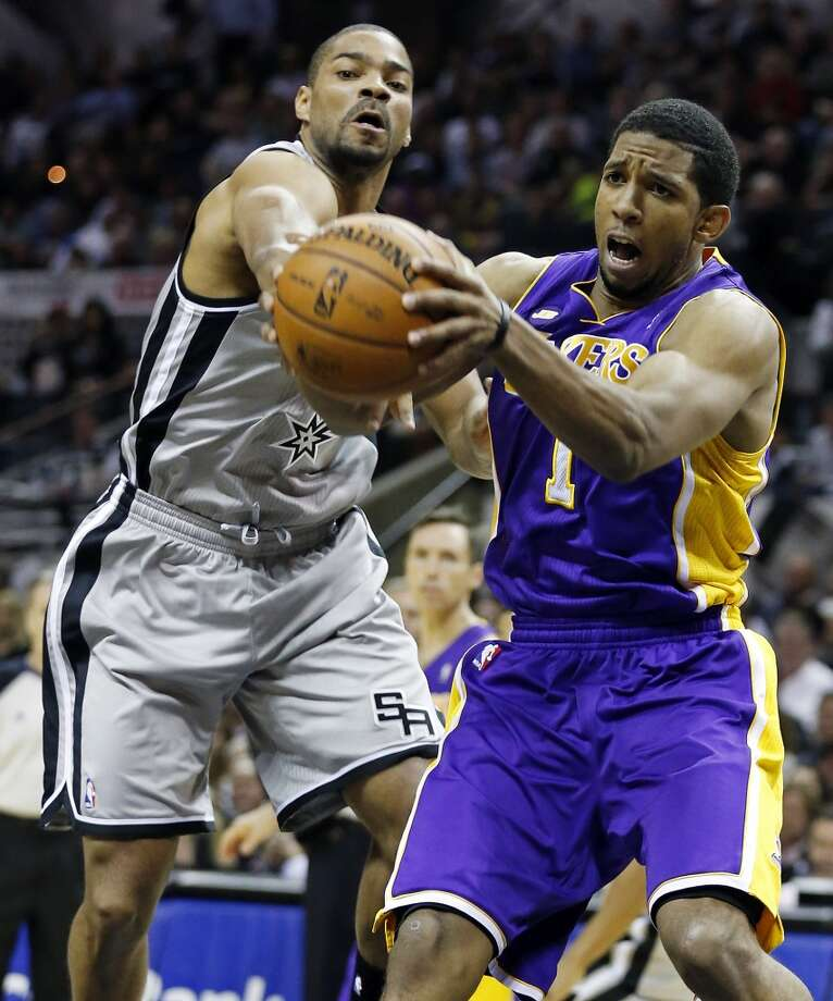 San Antonio Spurs' Gary Neal and Los Angeles Lakers' Darius Morris grab for a loose ball during first half action of game 2 in the first round of the NBA Playoffs Wednesday April 24, 2013 at the AT&T Center.