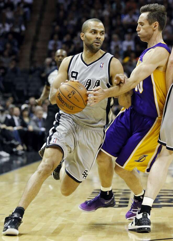 San Antonio Spurs' Tony Parker looks for room around Los Angeles Lakers' Steve Nash during second half action of game 2 in the first round of the NBA Playoffs Wednesday April 24, 2013 at the AT&T Center. The Spurs won 102-91.