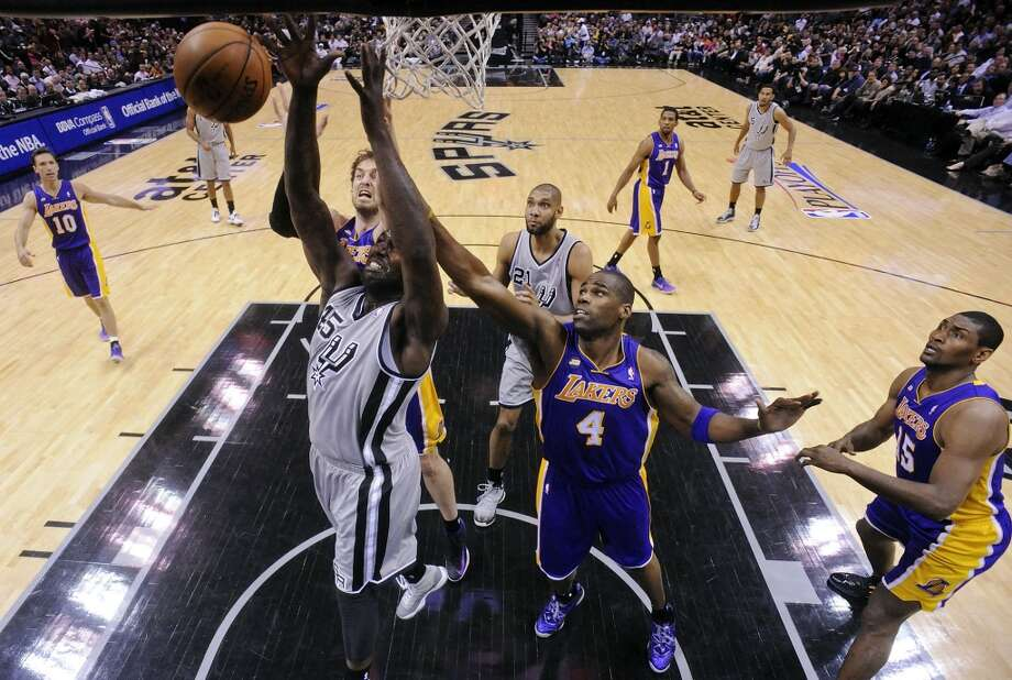 San Antonio Spurs' DeJuan Blair grabs for a rebound against Los Angeles Lakers' Antawn Jamison during first half action of game 2 in the first round of the NBA Playoffs Wednesday April 24, 2013 at the AT&T Center. The Spurs won 102-91.