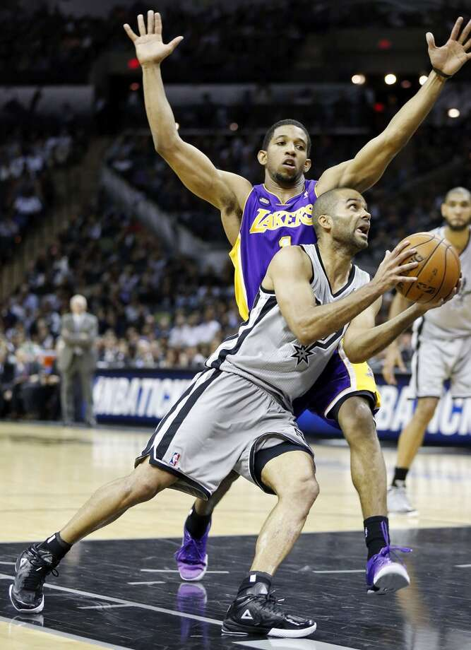 San Antonio Spurs' Tony Parker looks for room around Los Angeles Lakers' Darius Morris during second half action of game 2 in the first round of the NBA Playoffs Wednesday April 24, 2013 at the AT&T Center. The Spurs won 102-91.