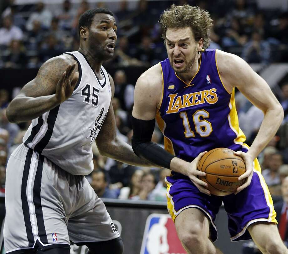 Los Angeles Lakers' Pau Gasol looks for room around San Antonio Spurs' DeJuan Blair during first half action of game 2 in the first round of the NBA Playoffs Wednesday April 24, 2013 at the AT&T Center.