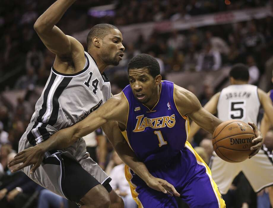San Antonio Spurs' Gary Neal defends against Los Angeles Lakers' Darius Morris in the second half of game 2 in the first round of the NBA Playoff at the AT&T Center, Wednesday, April 24, 2013. The Spurs won102-91 and lead the series 2-0.