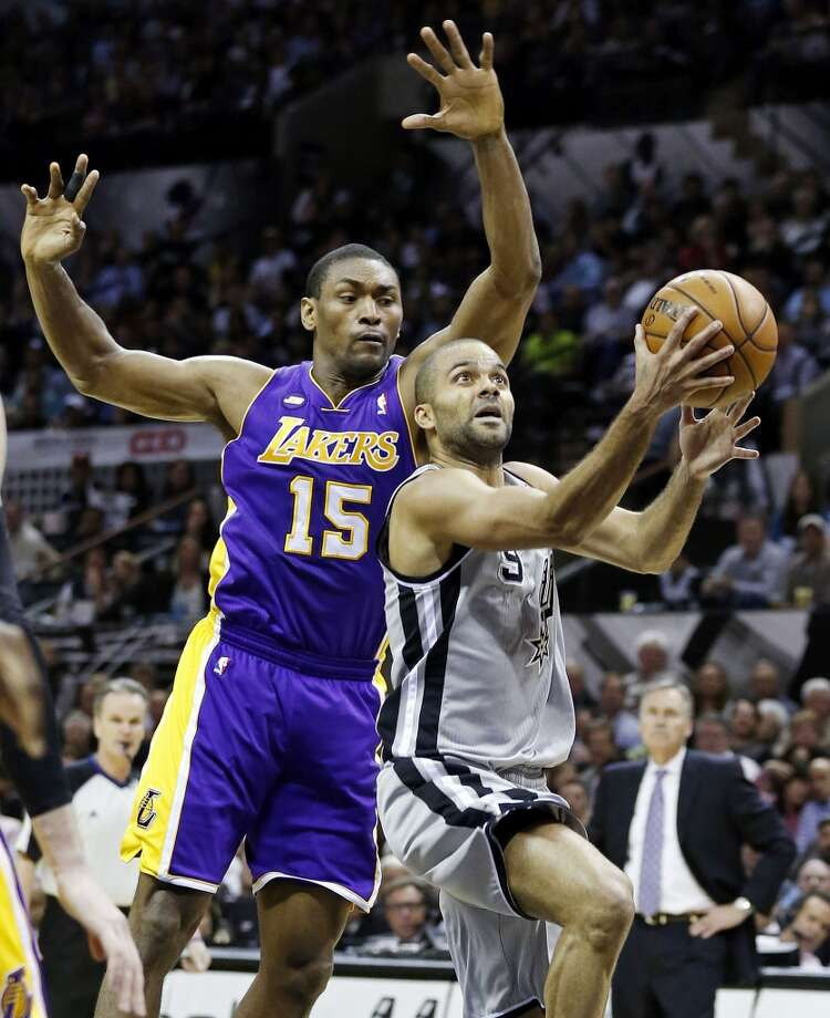 San Antonio Spurs' Tony Parker drives to the basket around Los Angeles Lakers' Metta World Peace during second half action of game 2 in the first round of the NBA Playoffs Wednesday April 24, 2013 at the AT&T Center. The Spurs won 102-91.