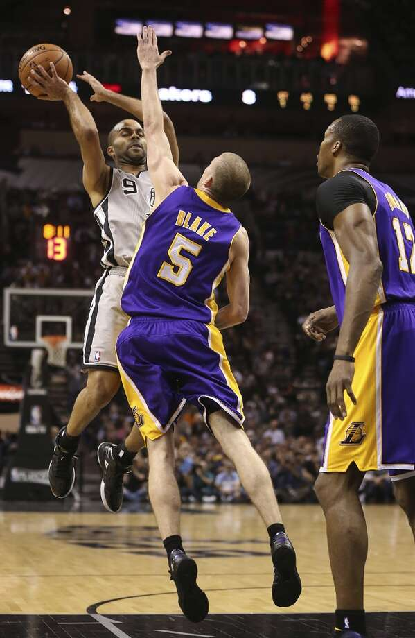 San Antonio Spurs' Tony Parker tries to get over Los Angeles Lakers' Steve Blake and Dwight Howard in the first half of game 2 in the first round of the NBA Playoff at the AT&T Center, Wednesday, April 24, 2013.