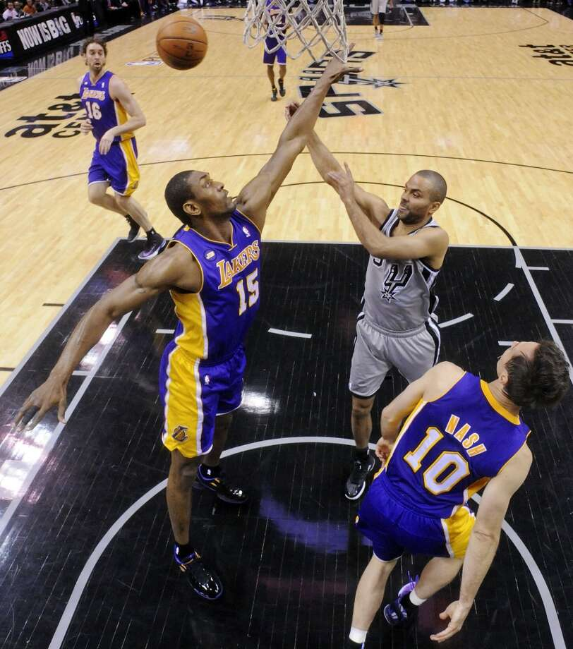 San Antonio Spurs' Tony Parker passes around Los Angeles Lakers' Metta World Peace and Los Angeles Lakers' Steve Nash during first half action of game 2 in the first round of the NBA Playoffs Wednesday April 24, 2013 at the AT&T Center. The Spurs won 102-91.