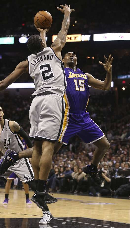 Los Angeles Lakers' Metta World Peace shoots over San Antonio Spurs' Kawhi Leonard in the second half of game 2 in the first round of the NBA Playoff at the AT&T Center, Wednesday, April 24, 2013. The Spurs won102-91 and lead the series 2-0.