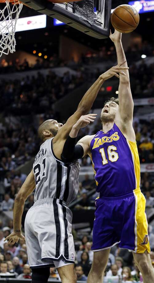 San Antonio Spurs' Tim Duncan defends Los Angeles Lakers' Pau Gasol during first half action of game 2 in the first round of the NBA Playoffs Wednesday April 24, 2013 at the AT&T Center.