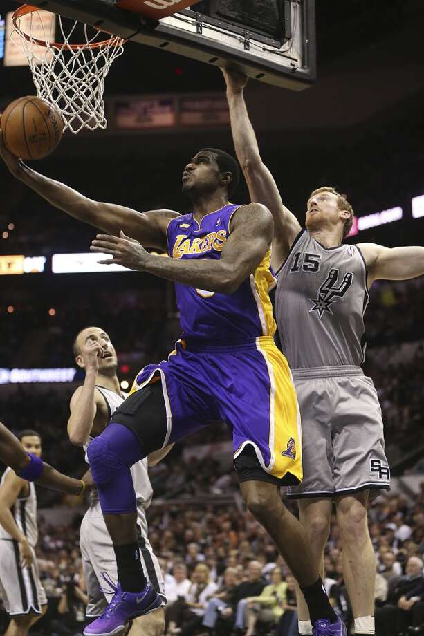 Los Angeles Lakers' Earl Clark goes under the basket as San Antonio Spurs' Matt Bonner defends in the second half of game 2 in the first round of the NBA Playoff at the AT&T Center, Wednesday, April 24, 2013. The Spurs won102-91 and lead the series 2-0.