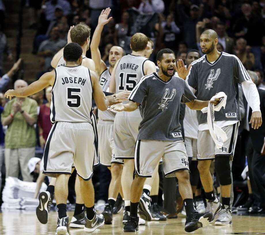 San Antonio Spurs' Patty Mills (center) and teammates celebrate during a second half timeout of game 2 in the first round of the NBA Playoffs against the Lakers Wednesday April 24, 2013 at the AT&T Center. The Spurs won 102-91.