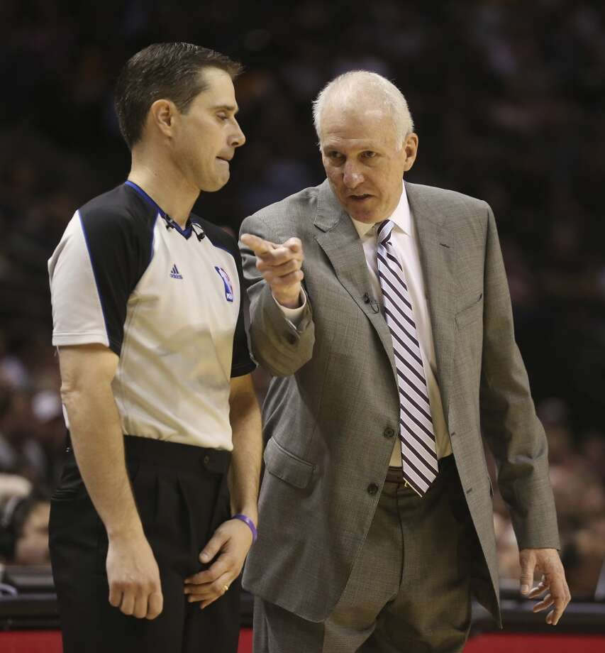 San Antonio Spurs head coach Gregg Popovich talks with official David Guthrie in the second half of game 2 in the first round of the NBA Playoff against the Los Angeles Lakers at the AT&T Center, Wednesday, April 24, 2013. The Spurs won102-91 and lead the series 2-0.