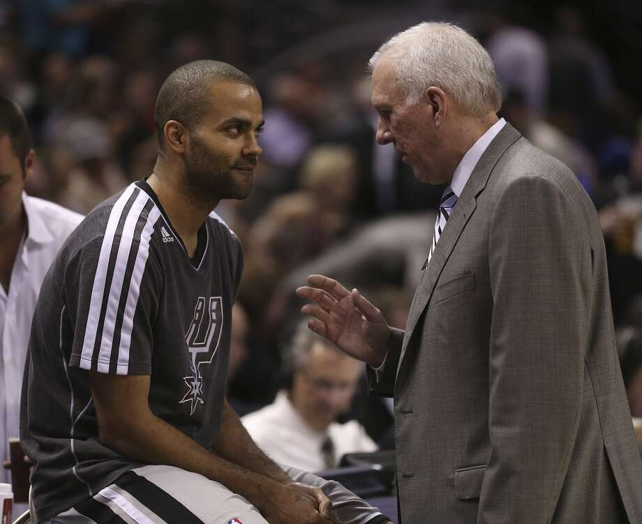 San Antonio Spurs head coach Gregg Popovich talks with Tony Parker before the start of the second half of game 2 in the first round of the NBA Playoff against the Los Angeles Lakers at the AT&T Center, Wednesday, April 24, 2013. The Spurs won102-91 and lead the series 2-0.