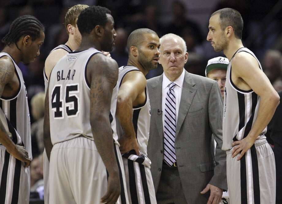 San Antonio Spurs head coach Gregg Popovich talks with the team during second half action of game 2 in the first round of the NBA Playoffs Wednesday April 24, 2013 at the AT&T Center. The Spurs won 102-91.