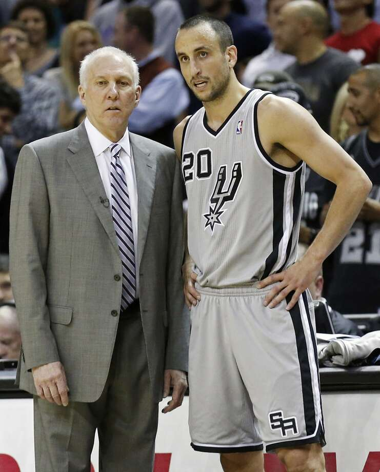 San Antonio Spurs head coach Gregg Popovich talks with San Antonio Spurs' Manu Ginobili during first half action of game 2 in the first round of the NBA Playoffs against the Los Angeles Lakers Wednesday April 24, 2013 at the AT&T Center.