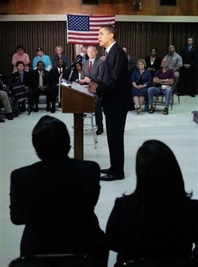 Democratic presidential hopeful Sen. Barack Obama, D-Ill., talks with veterans during a campaign stop at the American Legion Post 490 Friday, Feb. 29, 2008, in Houston, Texas. Photo: Rick Bowmer, AP / AP