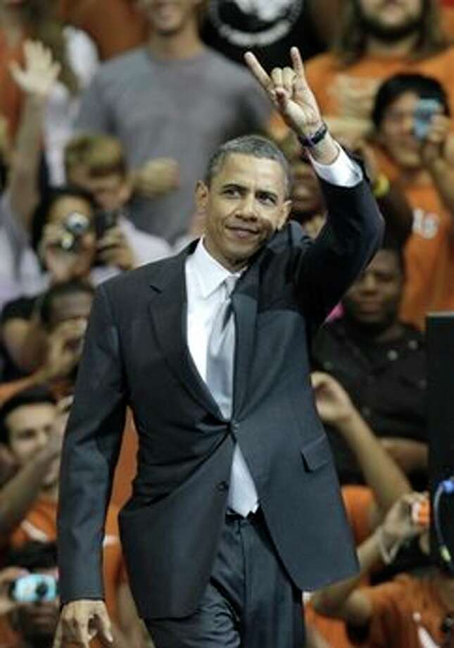 "President Barack Obama gives a ""hook 'em horns"" sign before a speech at Gregory Gym at the University of Texas in Austin, Texas, Monday, Aug. 9, 2010. Photo: LM Otero, AP / AP"