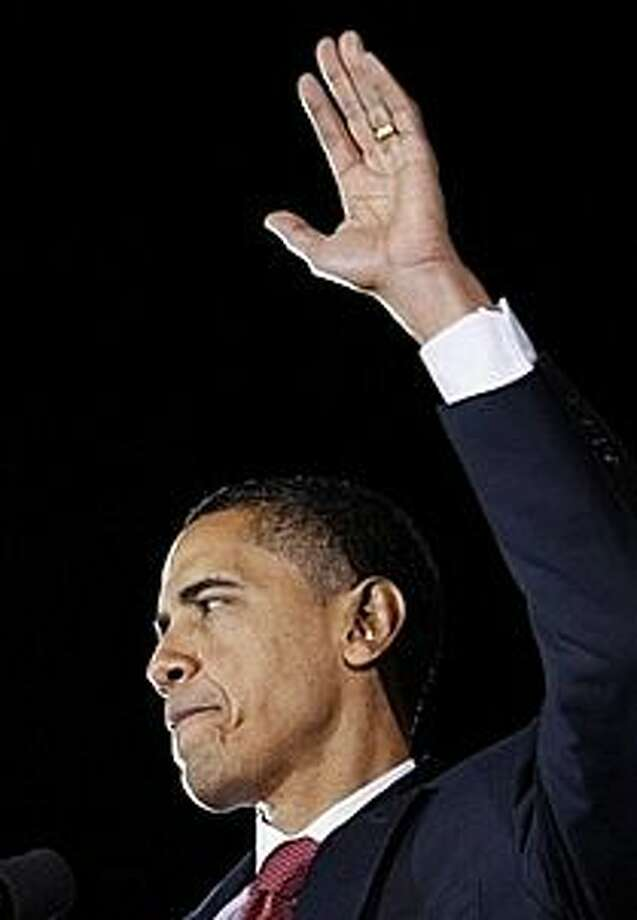 Barack Obma waves to a crowd in San Antonio.