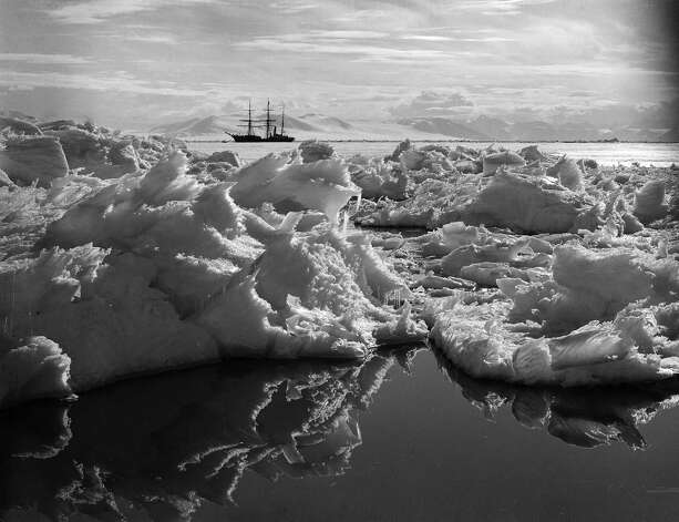 Beautiful ice reflections in the water with the Terra Nova ship in the background. Photo: Popperfoto, H.G. Pointing/Terra Nova / Popperfoto