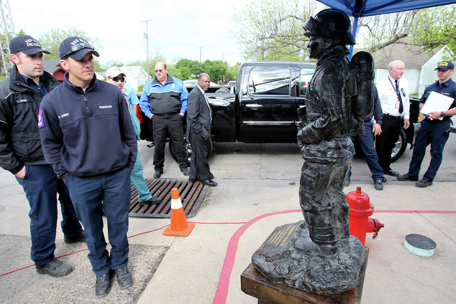 Visiting firefighters check out a memorial statue donated to the West fire department by the city of Hempstead , Texas  on  April 25 2013.  Leaders from Hempstead said that five more statues will be presented so that West will have one for each of their fallen firefighters. Photo: TOM REEL