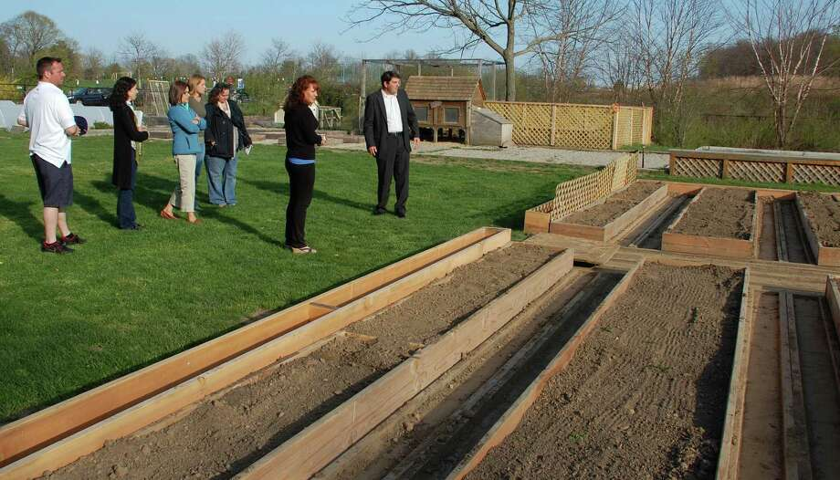 Mike Aitkenhead, steward of Wakeman Town Farm, shows committee members the new plots designed for vegetable and flower gardening at the town-owned agricultural center.  WESTPORT NEWS, CT 4/24/13 Photo: Jarret Liotta / Westport News contributed