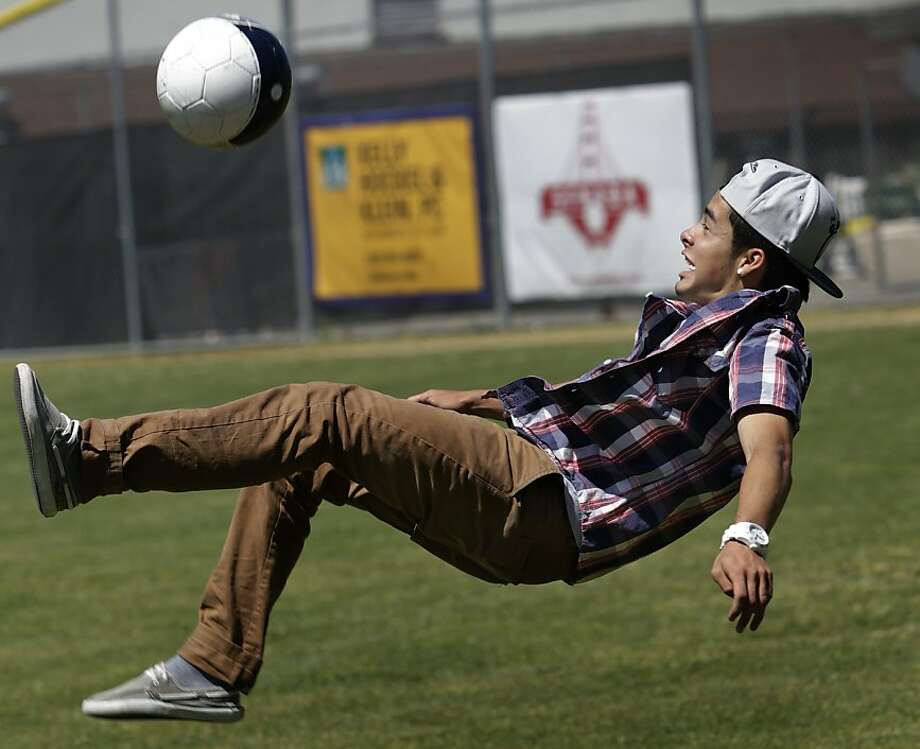 Sebastian Benitez, originally from Colombia, has fun on an Oakland field. Photo: Paul Chinn, The Chronicle