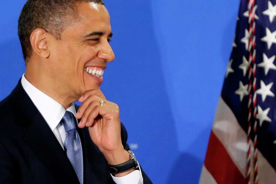 President Barack Obama smiles as he is introduced by Jim McNerney, chief executive officer of The Boeing Company, before speaking about the fiscal cliff during an address before the Business Roundtable, an association of chief executive officers, Wednesday, Dec. 5,2012, in Washington. Photo: Charles Dharapak, Associated Press / AP