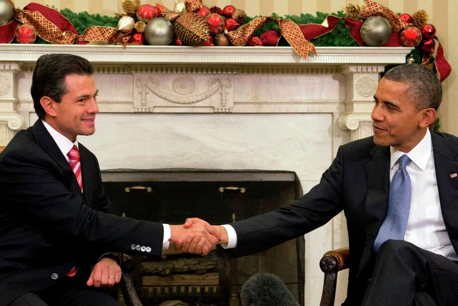 President Barack Obama shakes hands with Mexico\'s President-elect Enrique Pena Nieto prior to their meeting in the Oval Office of the White House in Washington, Tuesday, Nov. 27, 2012. Photo: Jacquelyn Martin, Associated Press / AP