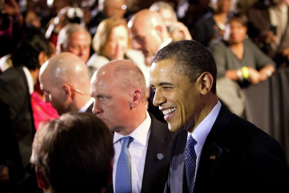President Barack Obama smiles as he greets supporters during a fundraising event at Minute Maid Park\'s Union Station on Friday, March 9, 2012, in Houston. Photo: Smiley N. Pool, Houston Chronicle / © 2012  Houston Chronicle
