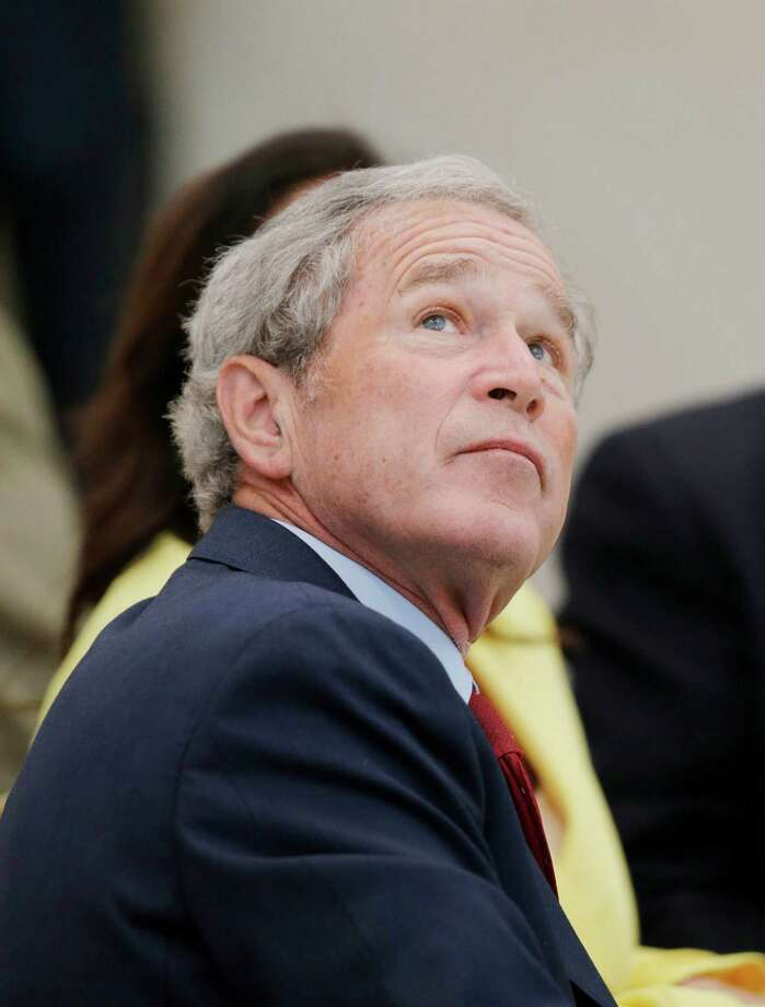 Former President George W. Bush participates in a signing ceremony for the joint use agreement between the National Archive and the George W. Bush Presidential Center Wednesday, April 24, 2013, in Dallas. Bush and his wife, Laura, attended Wednesday's ceremony in Dallas the day before the official dedication of the George W. Bush Presidential Center. The George W. Bush Foundation raised the money to build the center. The foundation donated the library and museum portion of the center to the National Archives, which provides access to presidential records, documents, historical materials and artifacts over time. Photo: David J. Phillip