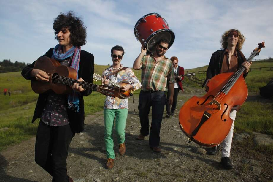 The Tumbleweed Wanderers, left-rt, Rob Fidel, Patrick Glynn, Daniel Blum, Jeremy Lyon and Zak Mandel-Romann walk through the Oakland hills before the making of a music video on April 4, 2013.