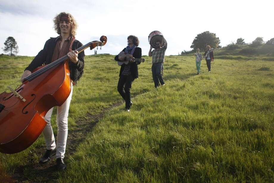 The Tumbleweed Wanderers, left-rt,  Zak Mandel-Romann, Rob Fidel, Daniel Blum, Patrick Glynn, and Jeremy Lyon walk through the Oakland hills before the making of a music video on April 4, 2013.