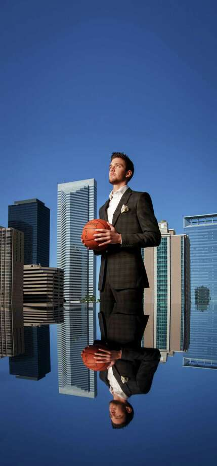 Houston Rockets' NBA basketball player Chandler Parsons poses for a photo in front of the Downtown Houston Skyline, Thursday, April 11, 2013, in Houston. ( Michael Paulsen / Houston Chronicle ) Photo: Michael Paulsen, Staff / © 2013 Houston Chronicle
