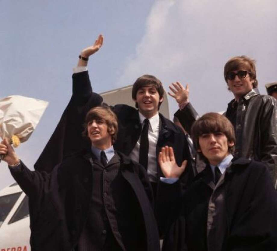 And their dads: The Beatles in 1964: John Lennon, George Harrison, Paul McCartney and Ringo Starr, pictured on their arrival in London following a tour of Australia. Photo: Fox Photos / Getty Images / SF
