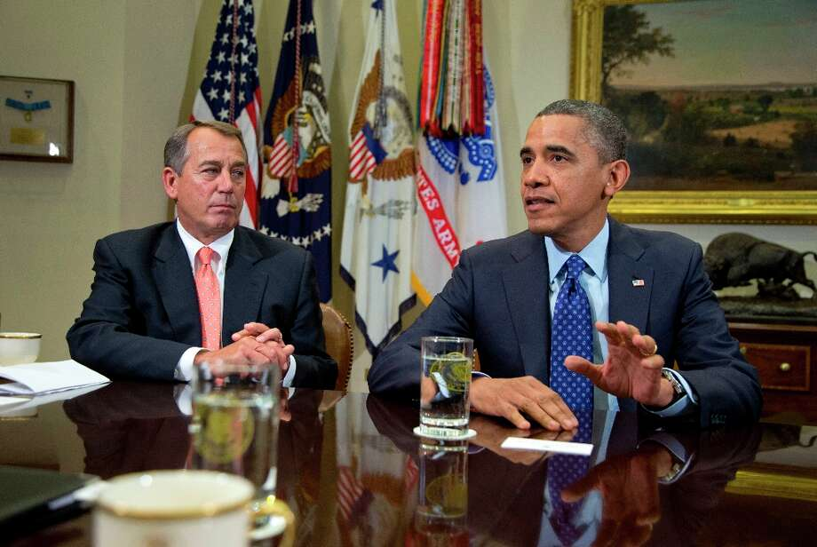 President Barack Obama, accompanied by House Speaker John Boehner of Ohio, speaks to reporters in the Roosevelt Room of the White House in Washington as he hosted a meeting of the bipartisan, bicameral leadership of Congress to discuss the deficit and economy. Photo: Carolyn Kaster, Associated Press / AP