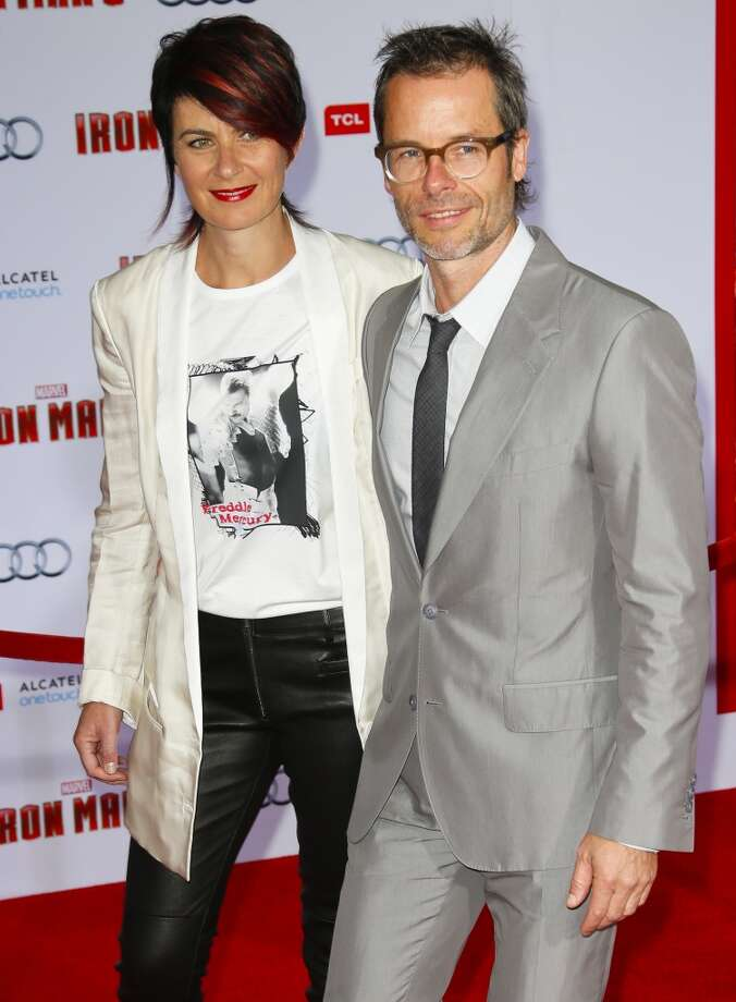 HOLLYWOOD, CA - APRIL 24:  Actor Guy Pearce (R) and his wife, Kate Mestitz, attend the premiere of Walt Disney Pictures' 'Iron Man 3' at the El Capitan Theatre on April 24, 2013 in Hollywood, California.  (Photo by Imeh Akpanudosen/Getty Images)