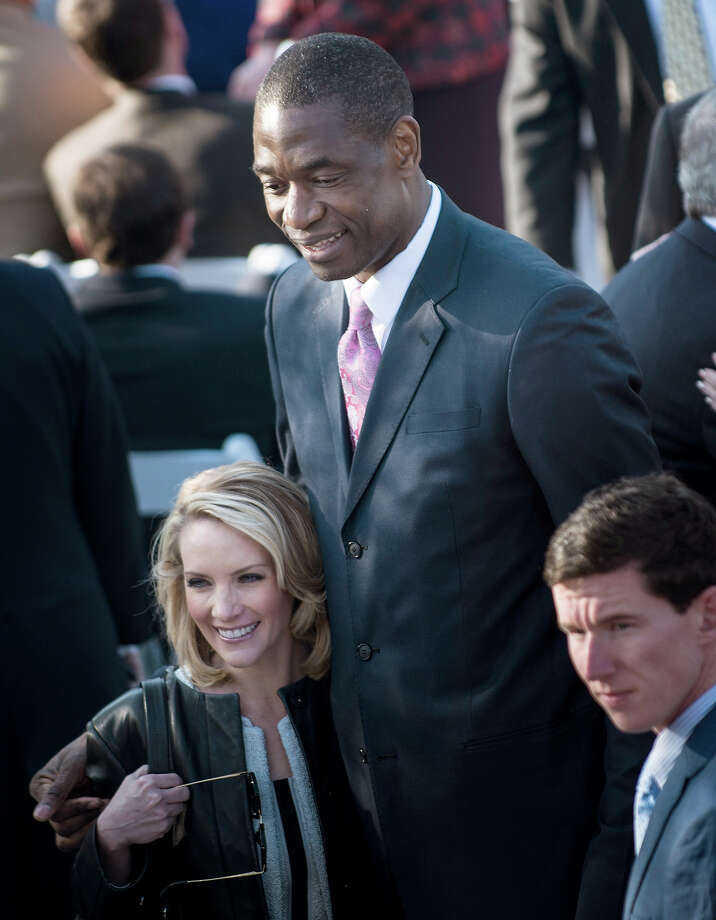 Former White House Press Secretary Dana Perino stands with former NBA Houston Rockets player Dikembe Mutombo before a dedication ceremony at the George W. Bush Library and Museum on the grounds of Southern Methodist University April 25, 2013 in Dallas, Texas. The Bush library is dedicated to chronicling the presidency of the United State's 43rd President, George W. Bush. Photo: BRENDAN SMIALOWSKI, AFP/Getty Images / 2013 AFP