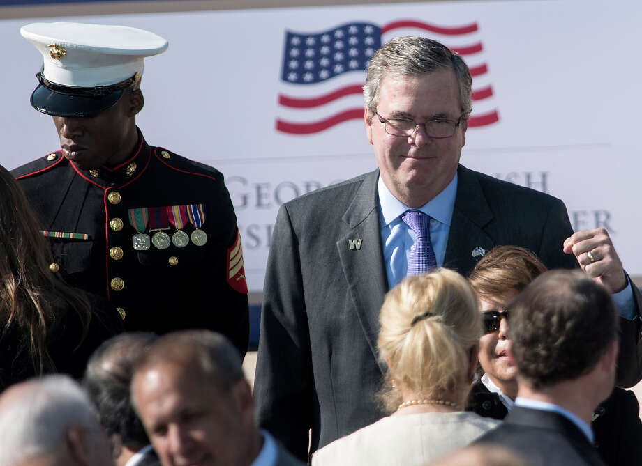Former Florida Governor Jeb Bush arrives for the dedication ceremony at the George W. Bush Library and Museum on the grounds of Southern Methodist University April 25, 2013 in Dallas, Texas. The Bush library is dedicated to chronicling the presidency of the United State's 43rd President, George W. Bush. Photo: BRENDAN SMIALOWSKI, AFP/Getty Images / 2013 AFP