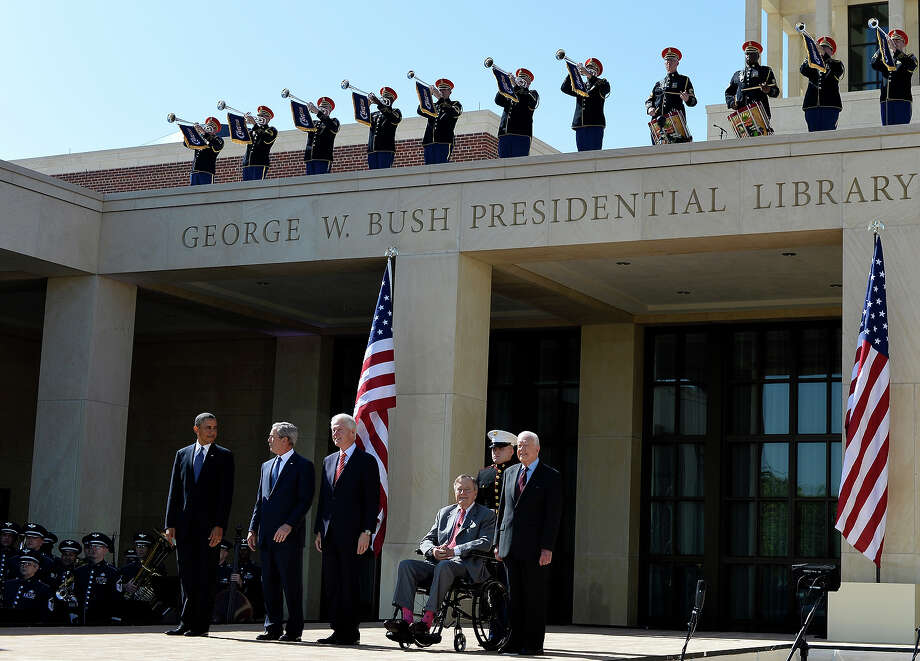 US President Barack Obama (L) and former US presidents (L-R) George W. Bush, Bill Clinton, George H.W. Bush and Jimmy Carter arrive on stage for the George W. Bush Presidential Center dedication ceremony in Dallas, Texas, on April 25, 2013. Photo: JEWEL SAMAD, AFP/Getty Images / 2013 AFP