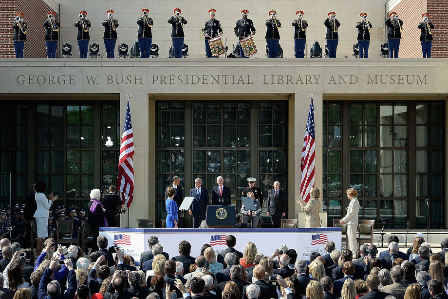 (L-R) Former first lady Laura Bush, U.S. President Barack Obama, former President George W. Bush, former President Bill Clinton, former President George H.W. Bush and former President Jimmy Carter attend the opening ceremony of the George W. Bush Presidential Center April 25, 2013 in Dallas, Texas. The Bush library, which is located on the campus of Southern Methodist University, with more than 70 million pages of paper records, 43,000 artifacts, 200 million emails and four million digital photographs, will be opened to the public on May 1, 2013. The library is the 13th presidential library in the National Archives and Records Administration system. Photo: Kevork Djansezian, Getty Images / 2013 Getty Images