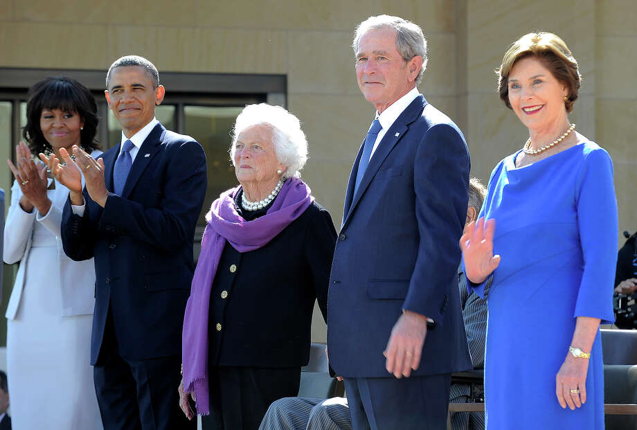 (L-R) US First Lady Michelle Obama, US President Barack Obama, former First Lady Barbara Bush, former US President George H.W. Bush(hidden), former US President George W. Bush and Laura Bush stand on stage during the George W. Bush Presidential Center dedication ceremony in Dallas, Texas, on April 25, 2013. Photo: JEWEL SAMAD, AFP/Getty Images / 2013 AFP