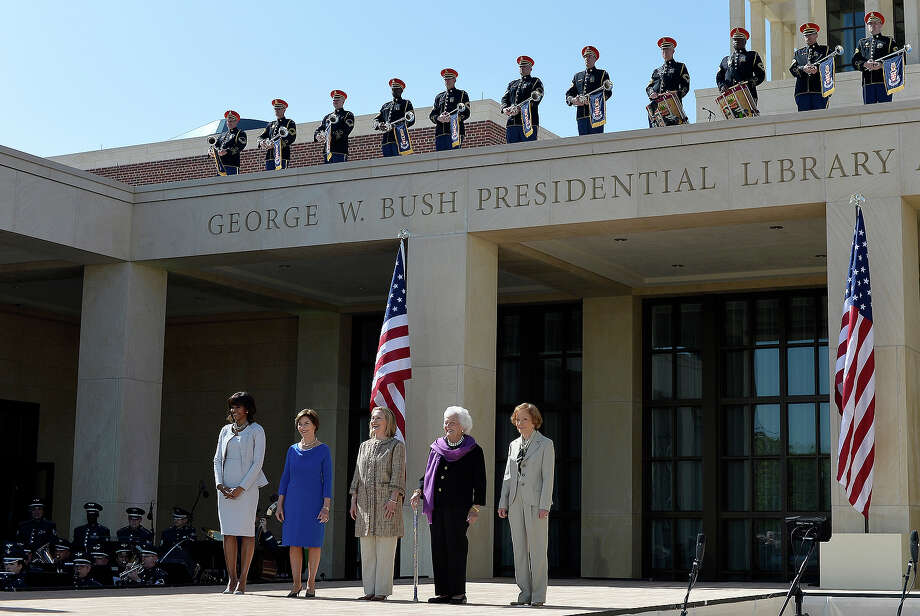 US First Lady Michelle Obama (L) and former First Ladies (L-R) Laura Bush, Hillary Clinton, Barbara Bush and Rosalynn Carter arrive on stage to attend the George W. Bush Presidential Center dedication ceremony in Dallas, Texas, on April 25, 2013. Photo: JEWEL SAMAD, AFP/Getty Images / 2013 AFP