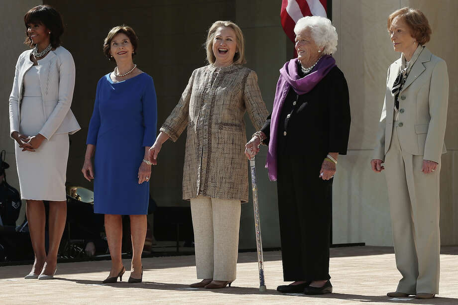 (L-R) First lady Michelle Obama, former first lady Laura Bush, former first lady Hillary Clinton, former first lady Barbara Bush and former first lady Rosalynn Carter attend the opening ceremony of the George W. Bush Presidential Center April 25, 2013 in Dallas, Texas. The Bush library, which is located on the campus of Southern Methodist University, with more than 70 million pages of paper records, 43,000 artifacts, 200 million emails and four million digital photographs, will be opened to the public on May 1, 2013. The library is the 13th presidential library in the National Archives and Records Administration system. Photo: Alex Wong, Getty Images / 2013 Getty Images
