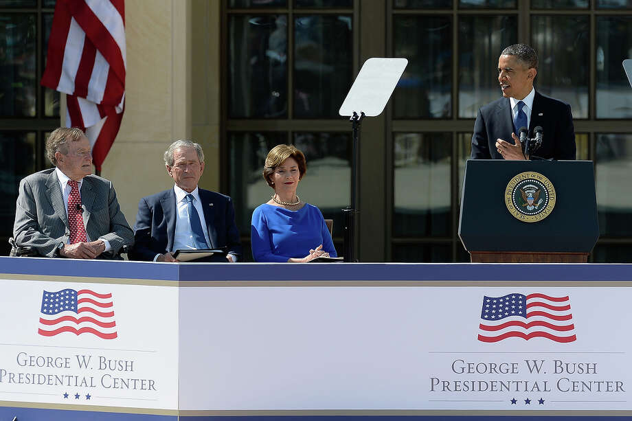 U.S. President Barack Obama (R) speaks as (L-R) former President George H.W. Bush, former President George W. Bush and former first lady Laura Bush listen during the opening ceremony of the George W. Bush Presidential Center April 25, 2013 in Dallas, Texas. The Bush library, which is located on the campus of Southern Methodist University, with more than 70 million pages of paper records, 43,000 artifacts, 200 million emails and four million digital photographs, will be opened to the public on May 1, 2013. The library is the 13th presidential library in the National Archives and Records Administration system. Photo: Kevork Djansezian, Getty Images / 2013 Getty Images